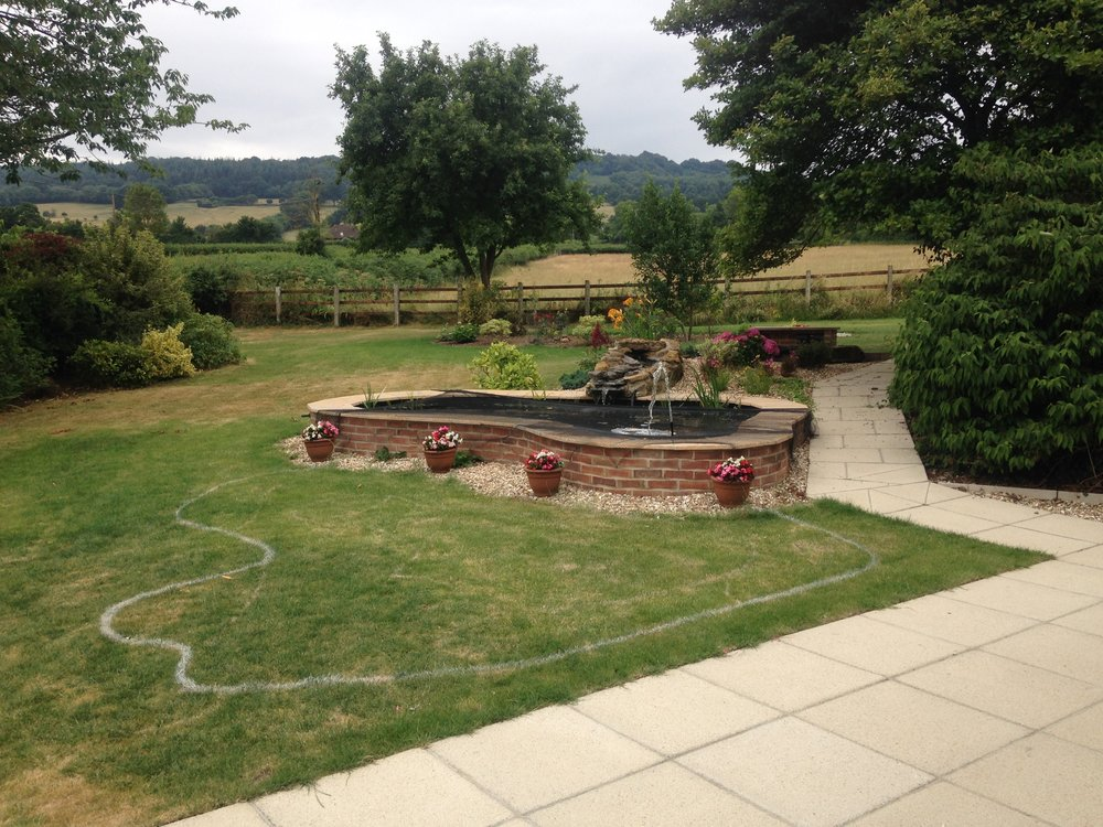 Before… - Formal fish pool, not at all in keeping with the surrounding landscape