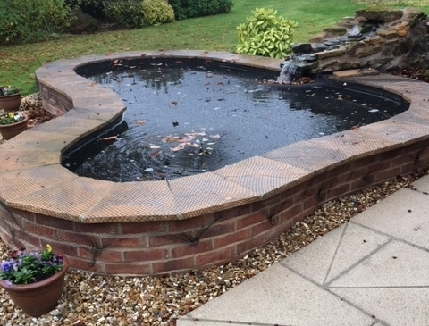 Before… - Imposing formal fish pool with a mounding plastic water feature