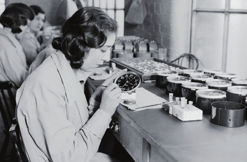 Photo of Grace Freyer.The women were paid .27 a dial, so they worked as fast as they could, using their mouths to wet the tips of the paintbrushes to achieve a fine point. Any extra radium dust was theirs, so they used it in toothpaste, in perfume, in many other cosmetic things to make themselves glow on dates. Photo credit: Messy Nessy Chick