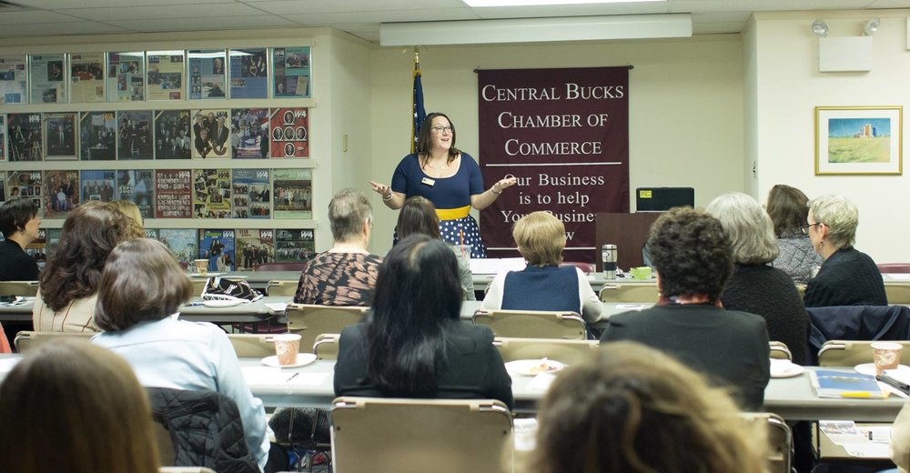 Dr. Donnelly is pictured here providing training to a group of women business leaders on employee engagement.