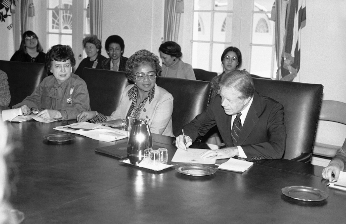 President Carter signing the proclamation of Women's History Week in 1980. To his right: Jane Pratt, president, Girls' Clubs of America and Gloria Johnson, treasurer, Coalition of Labor Union Women. Image Credit:  Time