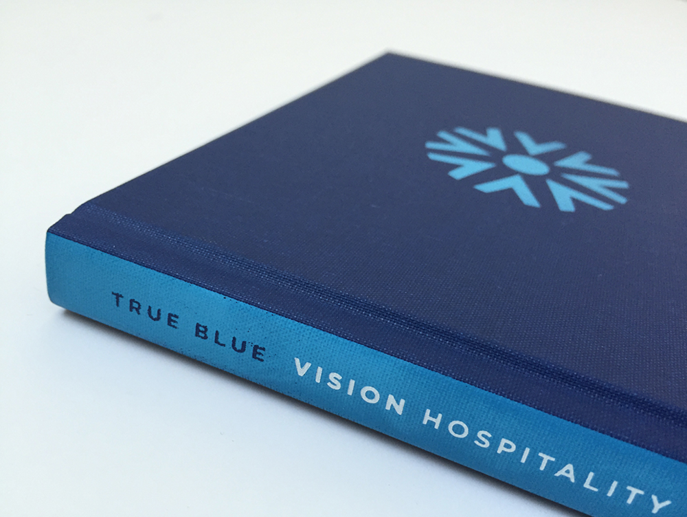 Copy of True Blue Book Print Binding Vision Hospitality Group