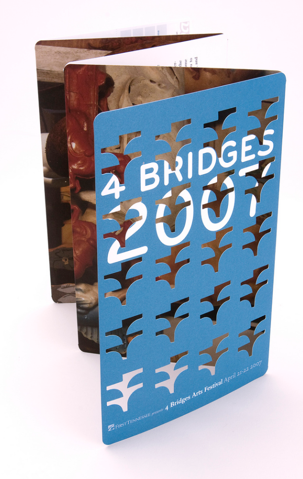 Die cut graphic design brochure typography