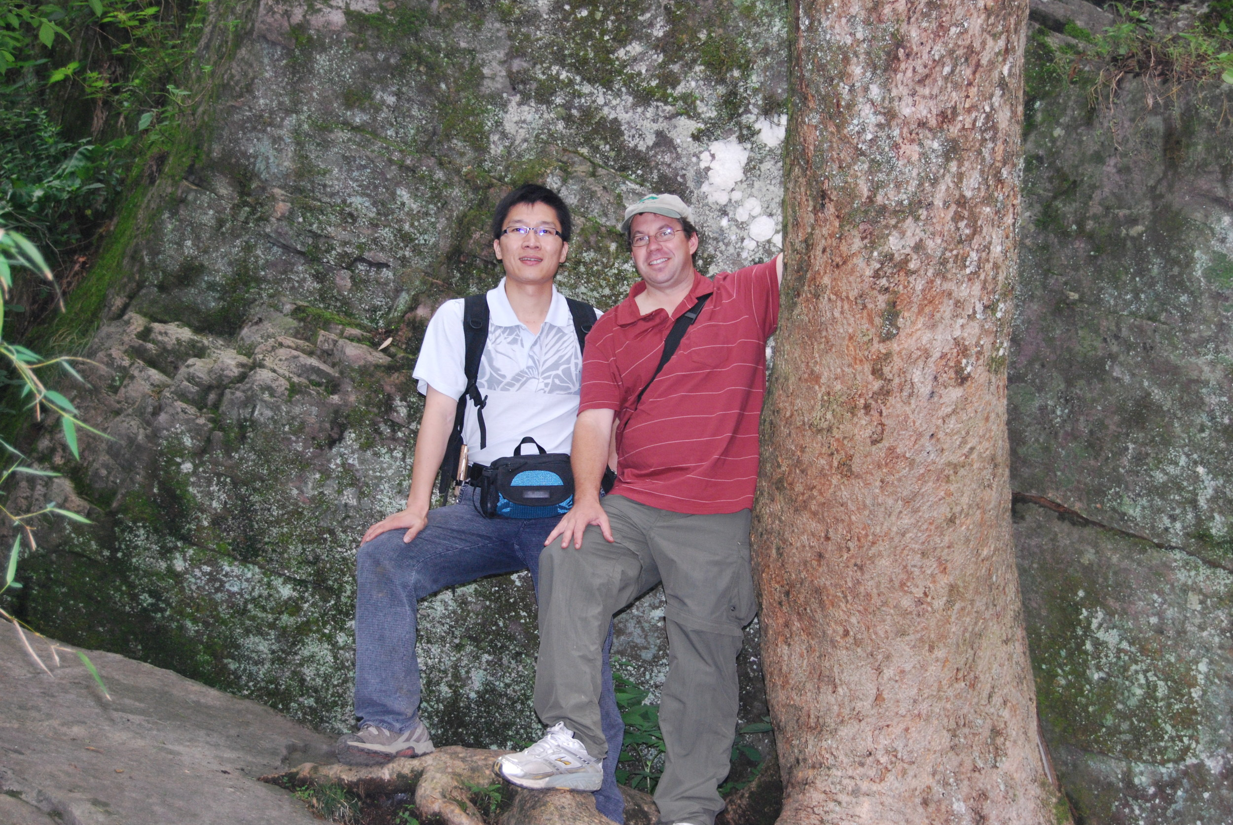 Dr. Yunpeng Zhao and me hugging a massive Emmenopterys on Tianmushan.