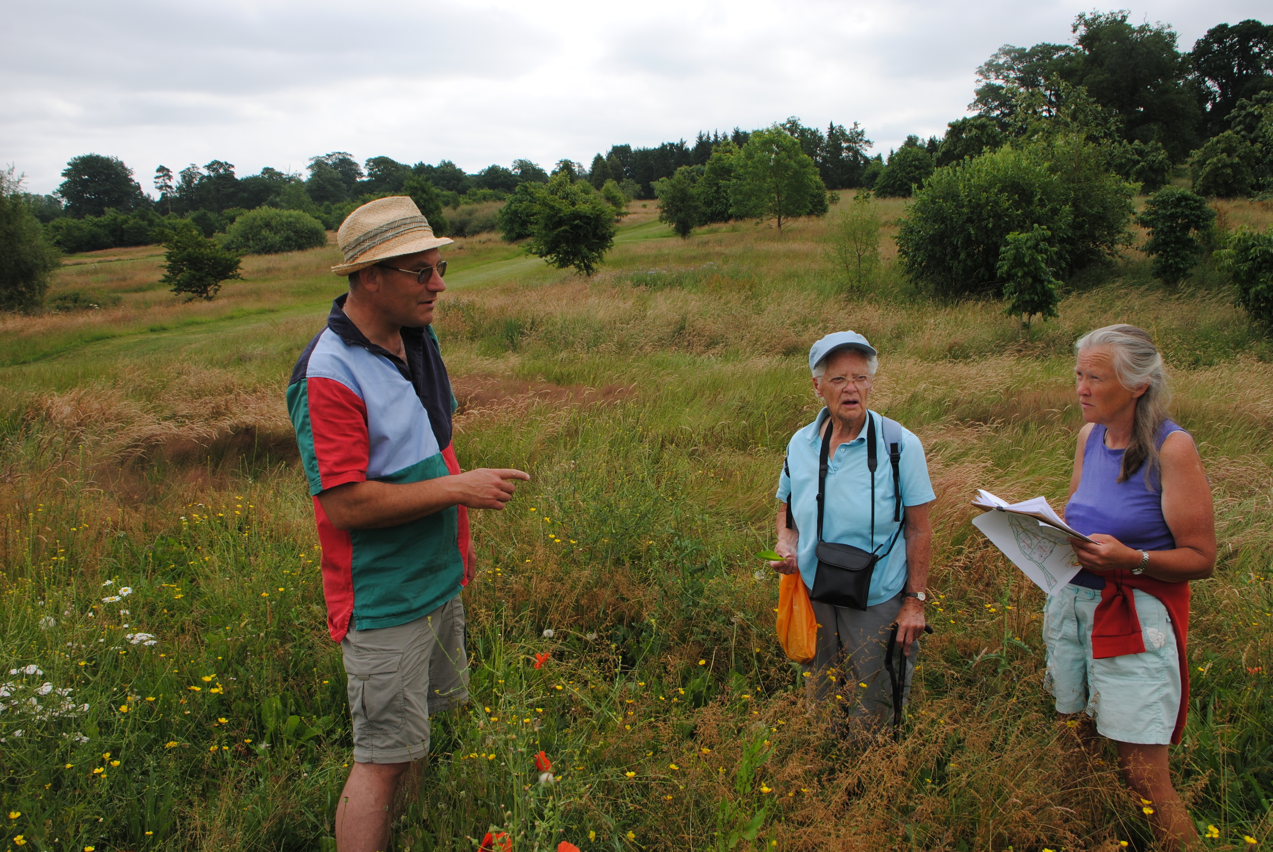 John with dedicated volunteers discussing the wildflower meadows to be established at the arboretum.
