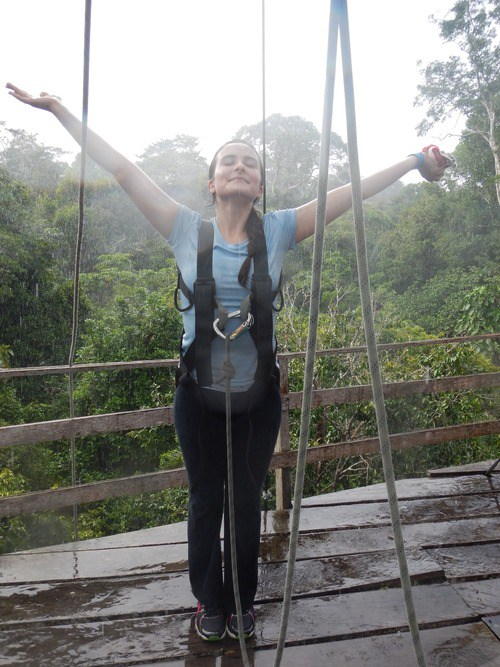 Giving into the torrential downpour at the top of the Ceiba tree after my climb
