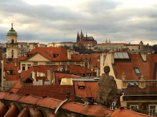 View of the Prague Castle across the river from a rooftop in Old Town