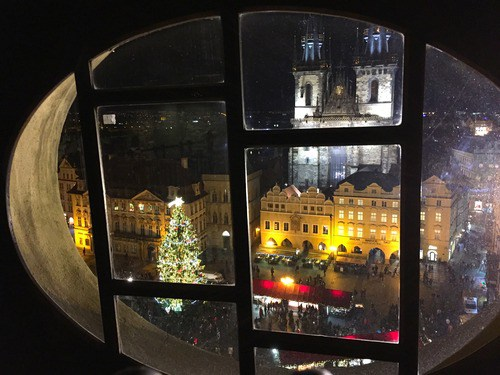 Peeking into Old Town Square from the top of the Astronomical Clock building