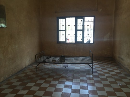 A glimpse of one of the rooms that prisoners would be tortured in at S-21. Their feet would be chained to the metal frame, and soldiers would use a plethora of torturing techniques to submit them into false confessions.