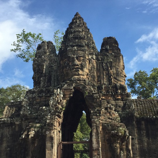 Smiling Buddha faces at the gateway to Angkor Thom