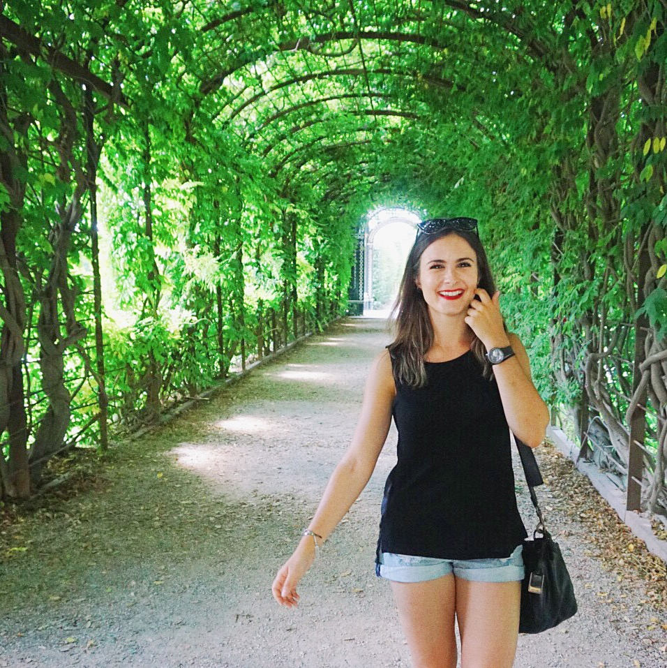 Walking through the leaf tunnel at Schonbrunn garden in Vienna
