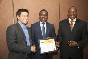 Sanergy Co-Founder David Auerbach (left) receives an award from  Acumen East Africa Duncan Onyango (centre) and SAP East Africa MD Andrew  Waititu