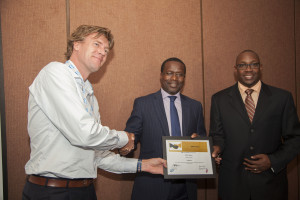 Solar now CEO Willem Nolens (left), receives an award from SAP East  Africa CEO Andrew Waititu (right) and Acumen East Africa CEO Duncan Onyango.