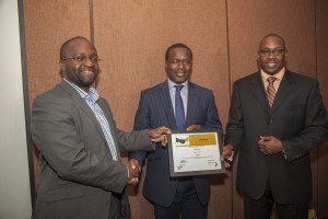 Sproxil CEO Ashifi Gogo, (left), receives a certificate from Acumen  East Africa CEO Duncan Onyango (centre) and Andrew Waititu MD SAP East  Africa
