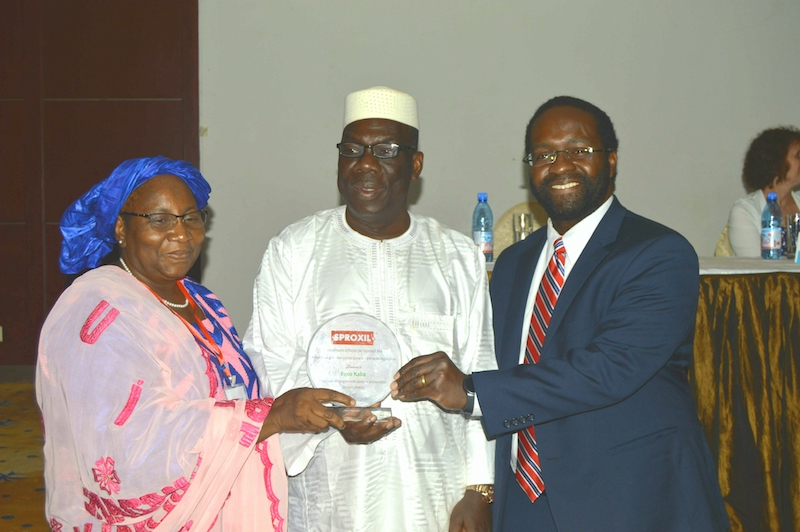 Hon. Minister of Agriculture (middle) presents plaque to CEO of Sproxil Mali's first client (left) with support from Sproxil CEO (right).