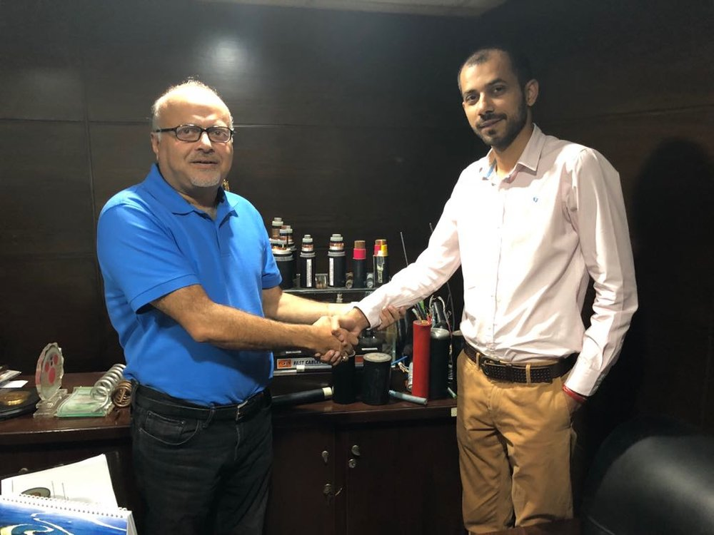 Sproxil Pakistan Managing Director, Mr. Faisal Raza congratulates Fast Tasdeeq head, Mr. Asif Javed.
