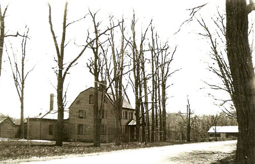 The Holman-Gerard House, ca. 1910.  The mill is partially visible to the right.  Photo from the Yaphank Historical Society.