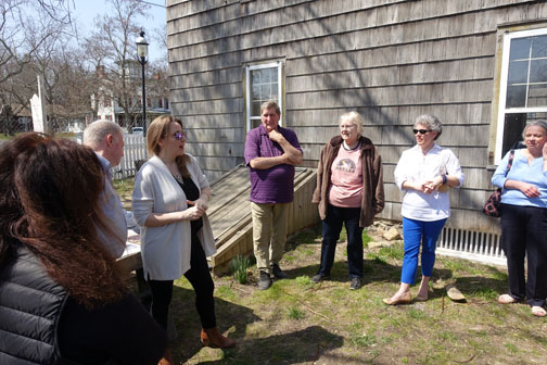 Sarah Kautz introduces the group to the restoration project outside the house. Twenty people toured the house with representatives from the Yaphank Historical Society, a restoration contractor and Suffolk County.