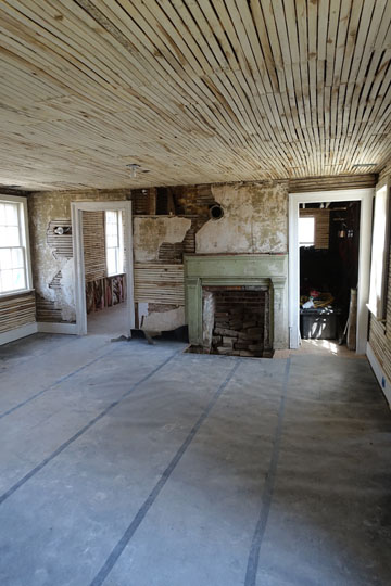 The addition at the rear is one of the largest rooms in the house, but it is not clear when this was added.  There is an unfinished attic above, reached by a hidden staircase.