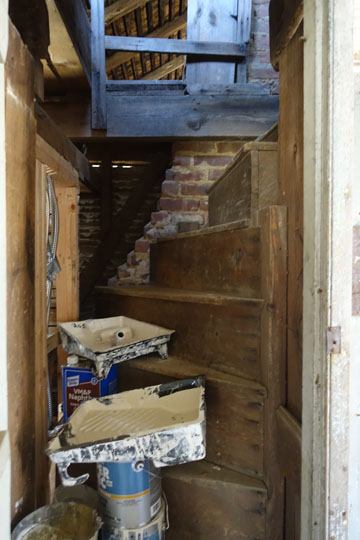 The secret stair to the attic from the shed, temporarily being used as storage for paint.