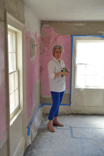 "Preservation Long Island Executive Director Alex Wolfe (my wife) shows off her ""Paint Tape Blue"" pants inadvertently color coordinated to the blue paint tape at the second floor hallway."