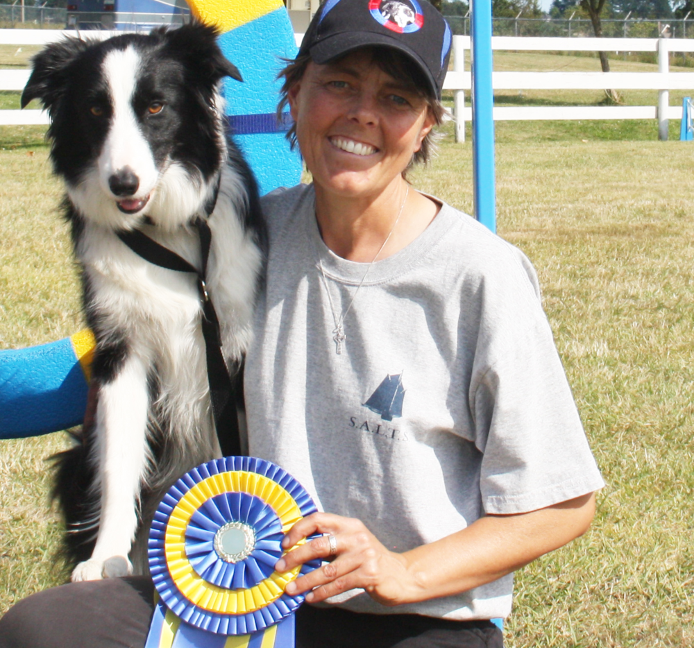 """Dorothy and her dog win their highest agility title — Agility Trial Champion of Canada (ATChC).  """"Get ready to learn from the best. Both Julie and Dorothy have great teaching skills and were able to pass on their knowledge in a clear and concise way. We trained with a variety of dogs in different environments which helped reinforce the techniques that they taught. When Julie worked with a dog she got results immediately proving her positive reinforcement techniques work. The course is full of information that will be applicable to starting your own business as a dog trainer. I really enjoyed the course and would recommend it to anyone who wants to get into working with dogs. I feel that I now have the tools I need to start my own business...bring on the puppies."""" — Starlene Wiseman"""