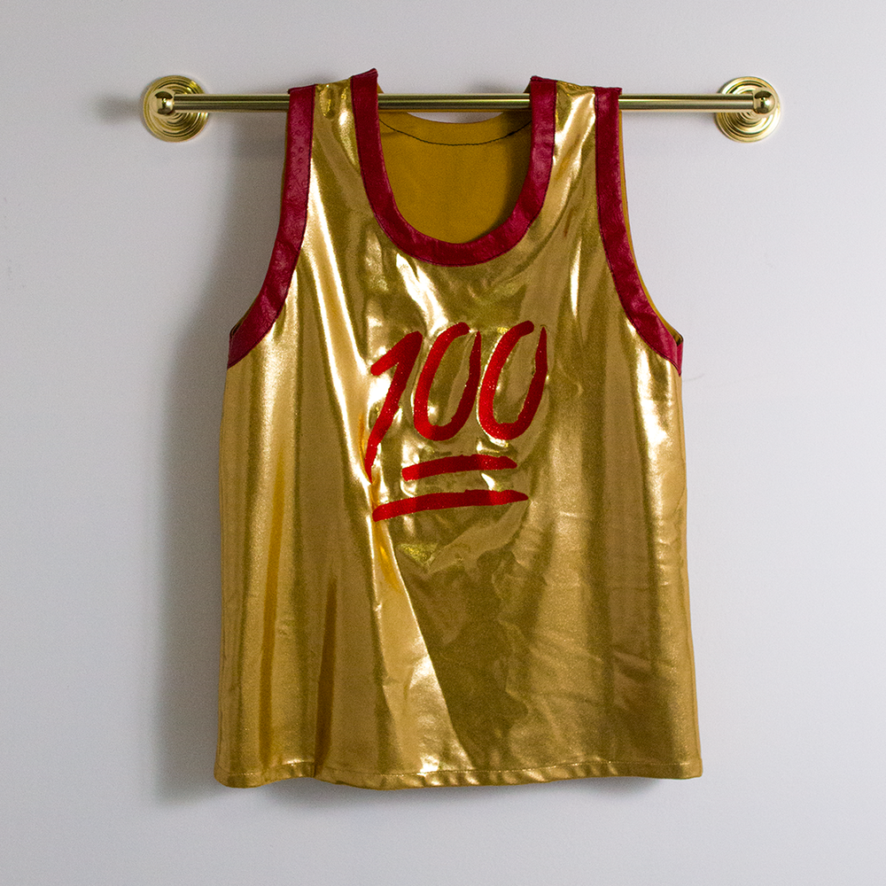 "Victor Solomon, ""Hunnit."" 2016. Gold lycra, red ostrich trim, embroidered embellishment. 36 x 24 in."