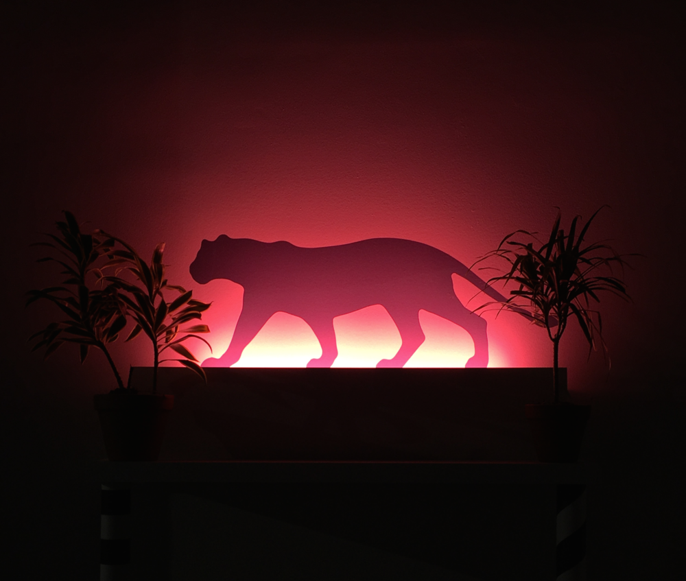"Dave Singley, ""Otho,""   2016. Acrylic plexi panther with shelf, live plants and neon. 18 x 24."