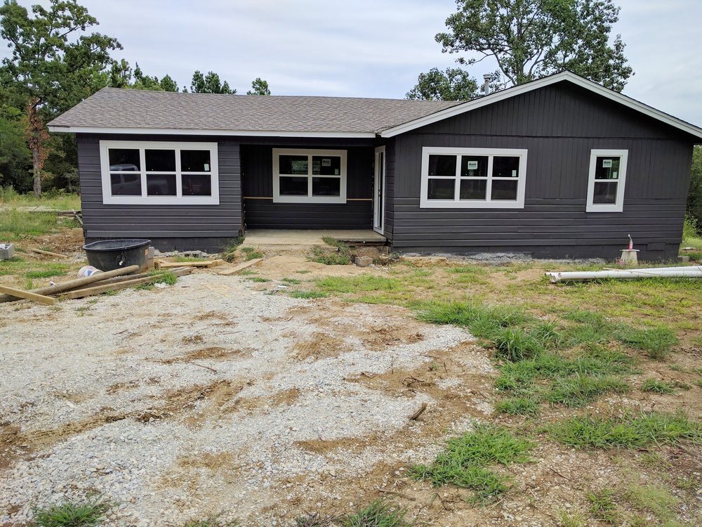 This is after siding and windows were installed. Lots of landscaping to do once this is all done!