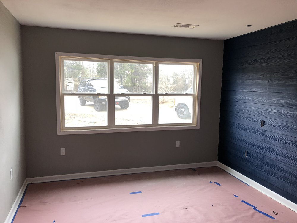 "So far...this is my favorite room. It is supposed to be our master. I love the navy ""shiplap"" wall."