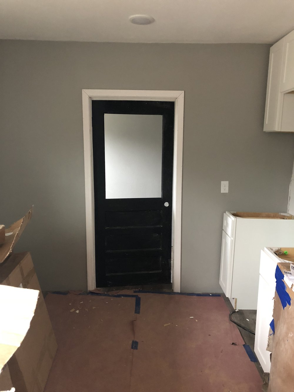 This door is a work in progress. This door was one of the originals on the house and I am re-purposing it as our pantry door. I have to give it a little more TLC. It got a little damaged during the remodel.