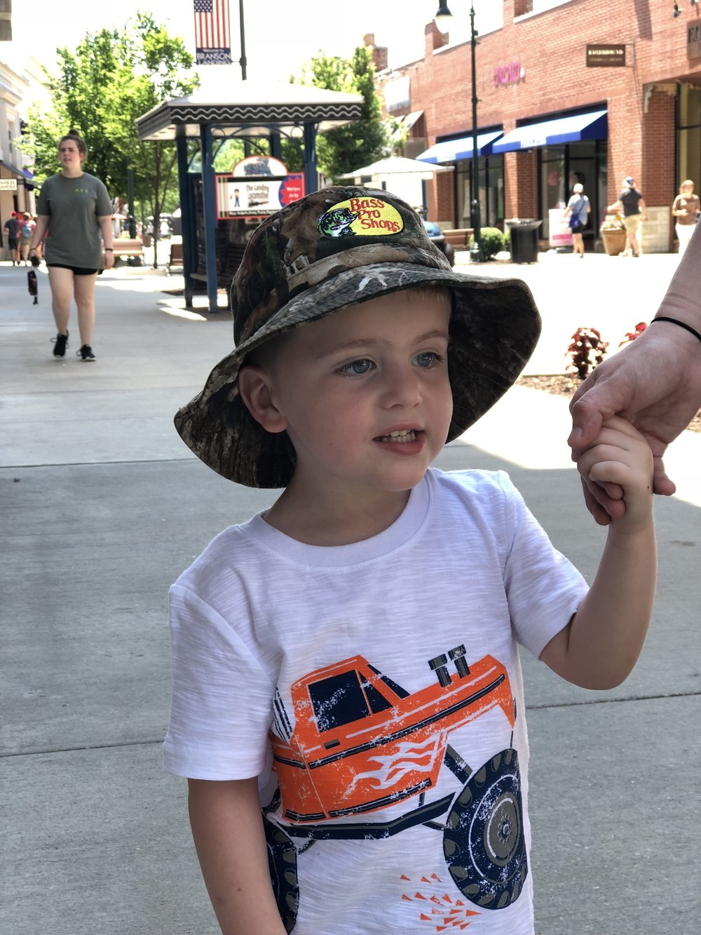 "Shopping at the Landing. He got a new ""fishing"" hat."