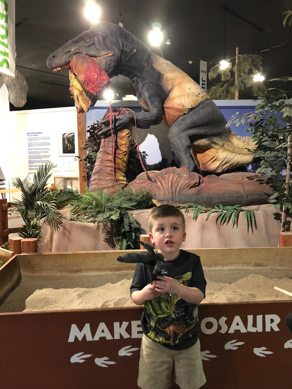 That dinosaur behind him is completely disgusting…