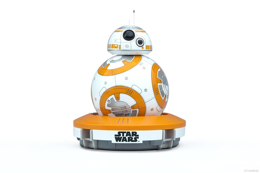 "I'm not super duper up on my Star Wars gear, but this little robot ""BB8"" has been highly recommended. May the force be with you! (Also perfectly applicable for adult man cubs.)"