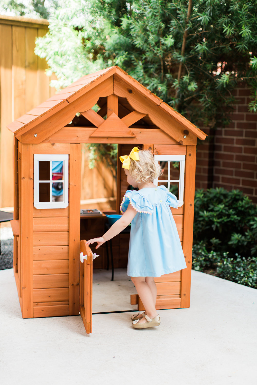Backyard Discover wooden playhouse - perfect for small backyards. Great for toddlers and little kids!
