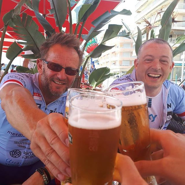 Happy boys on the front at Menton with a cold beer.