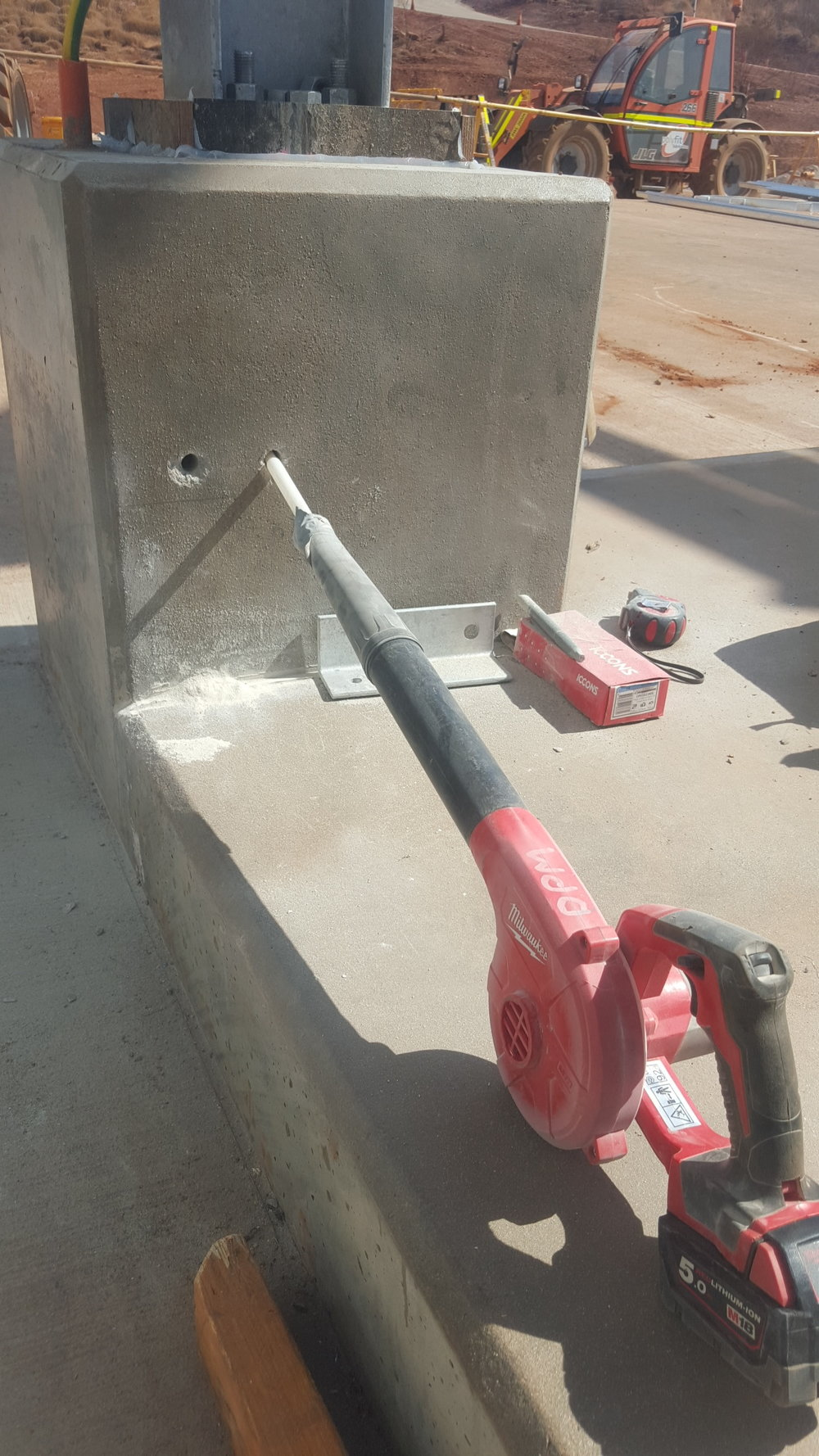 Preparation of chemical anchor holes.jpg