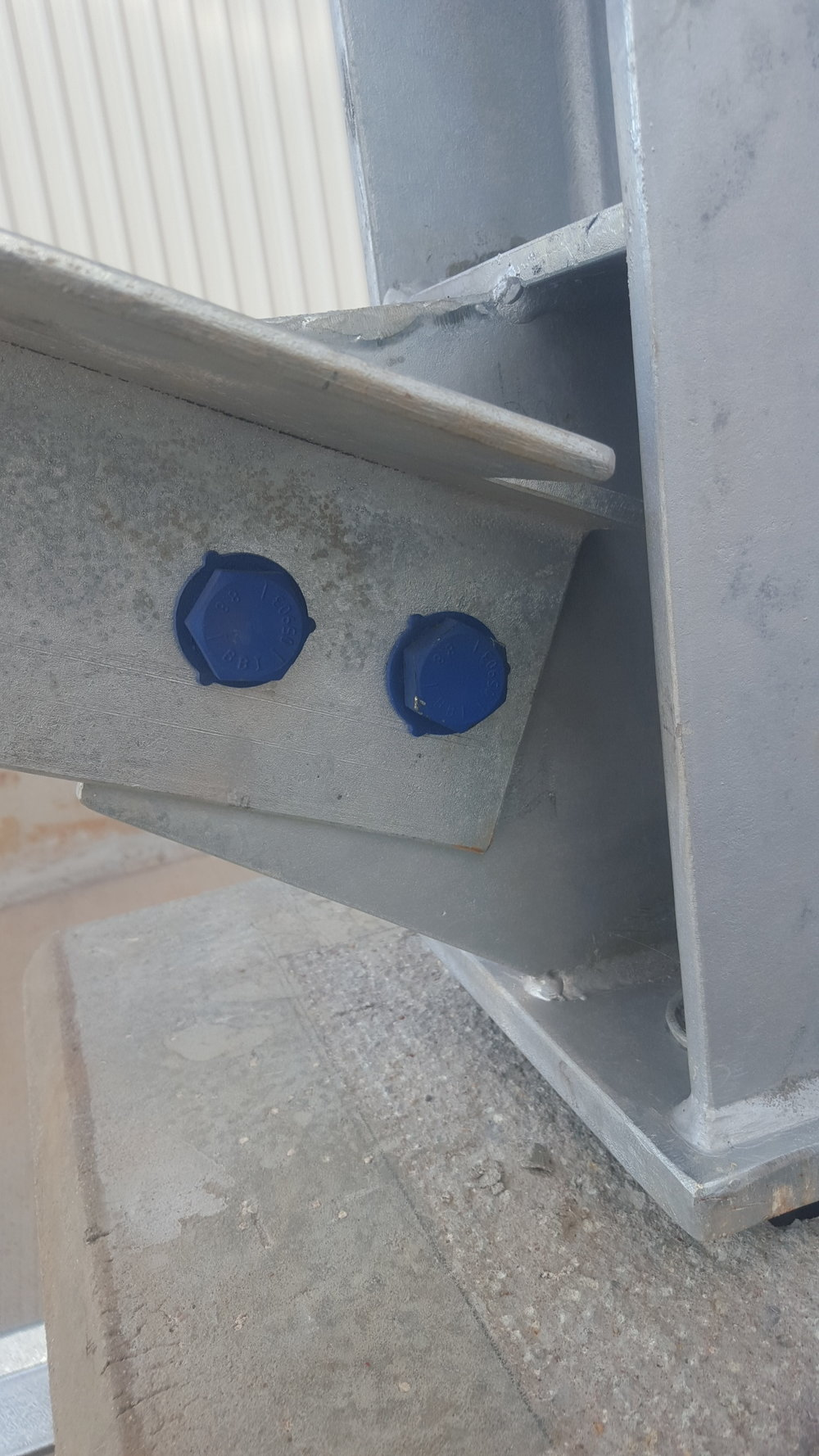 Xylene coated bolts at lower level with additional washer under head.jpg