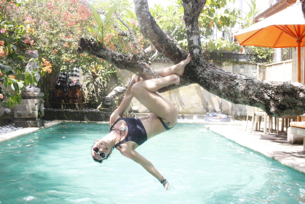 Sanur Beach, Bali. Monkeying around playing in the pool climbing trea