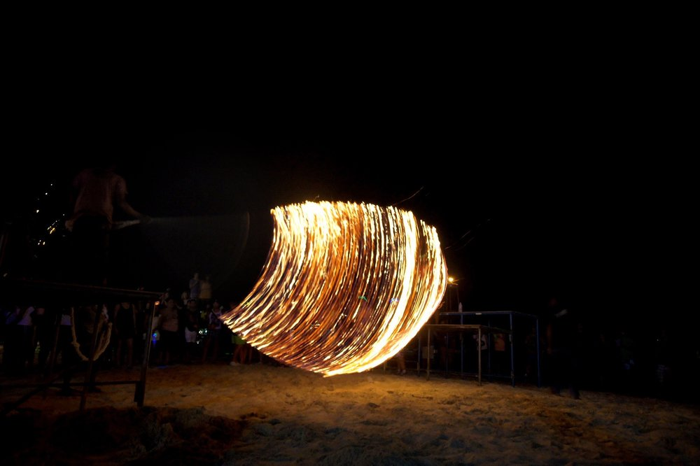 Fire jump rope at a Full Moon Party on Haad Rin Beach Koh Phangan Thailand