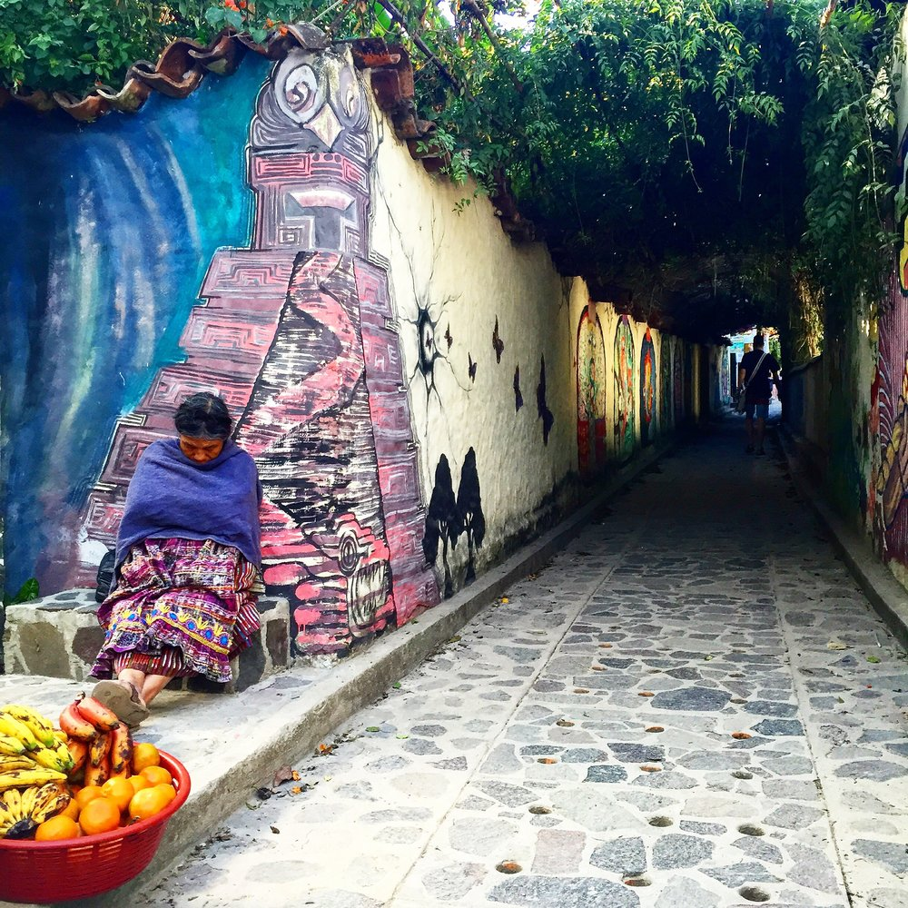 Wander through colorful street-art lined tunnels in San Marcos la Laguna.