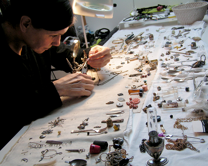 Sarah Joyce working in her studio, Joyce is also an artist, she designs bespoke signature wearable pieces that incorporate history, the objects are often a combination of found vintage components and elements.