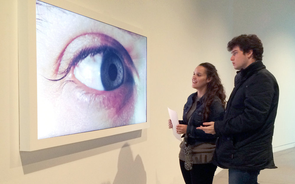 A couple of visitors eye up Rafael Lozano-Hemmer's interactive work entitled Surface Tension.