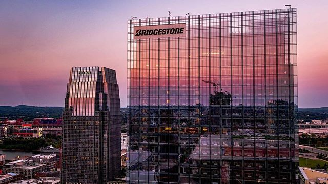 Sunset in Nashville next to @bridgestonemoto. Can you spot the mystery object? . . . . . . #nashville #musiccity #brickcity #nashvilletn #tennessee #bridgestone #glass #skyline #cityscale #skyscraper #reflection #sunset #drone #droning #drones #dronestagram #fromwhereidrone #droneheroes @thedroneu #droneu #getty #droneheroes #dronegear #countrymusic #country