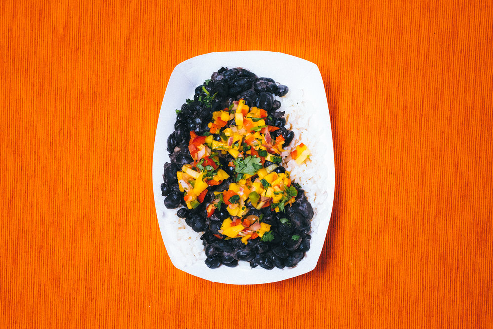 BLACK BEAN + MANGO 6 - VEGAN + GLUTEN FREE. Rice topped with black beans & mango salsa.