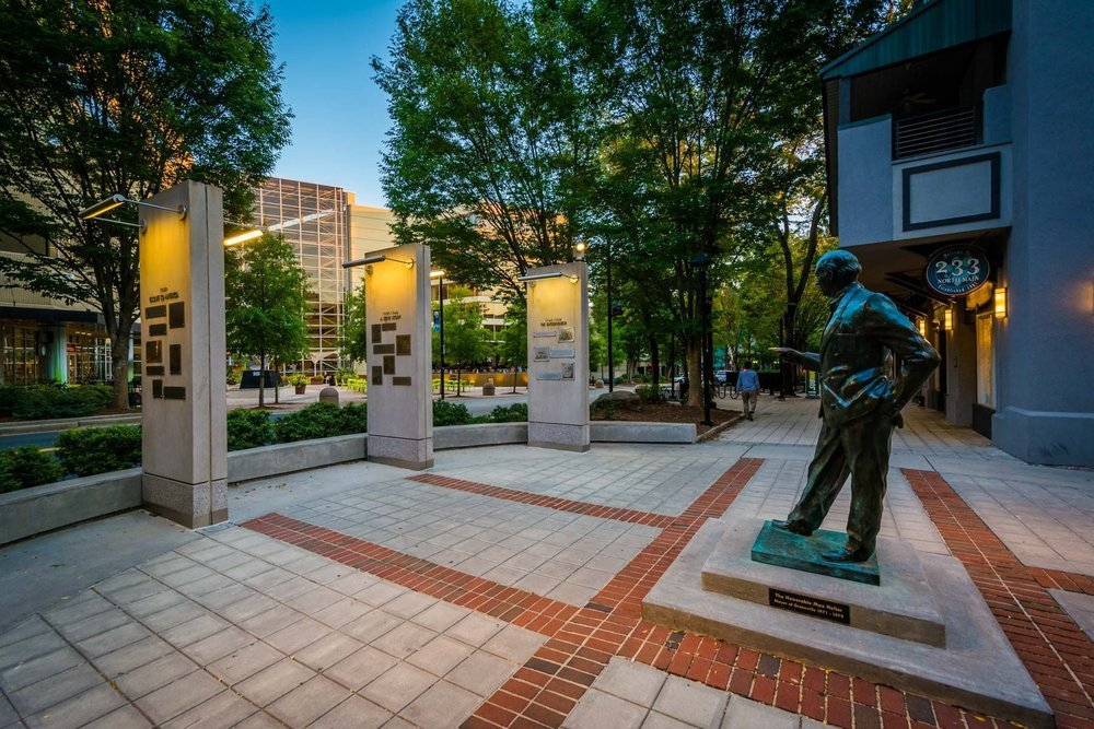 The leadership of Max Heller, who first envisioned Greenville's urban renaissance, is commemorated with a statue and plaza downtown.