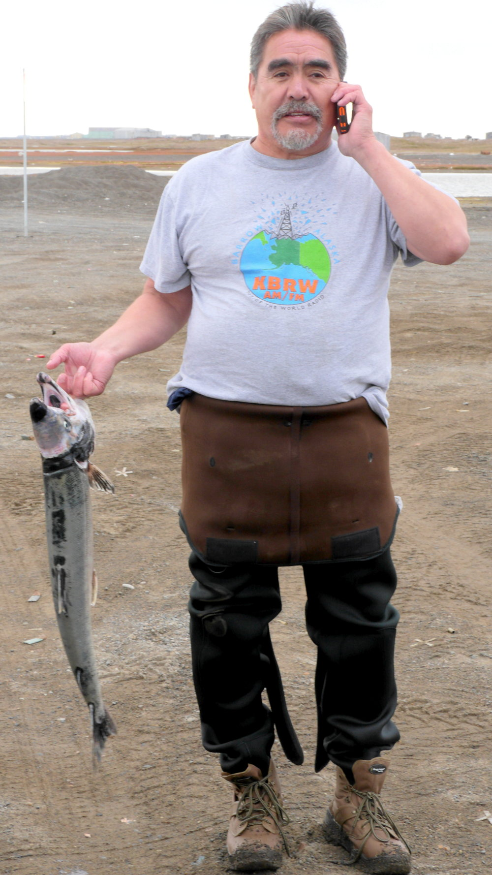 Barrow fisherman Bob Brouillette with a chum salmon freshly pulled from his gillnet in Elson Lagoon. (Photo credit: Liz McKenzie