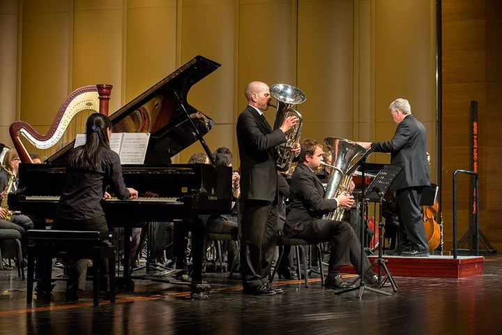 Danny Helseth, Jon Hansen, and Pei-Jung Huang in Beijing, China's National Performing Arts Centre performing Diversive Elements with the UW Wind Ensemble