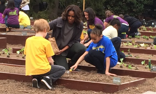 FLOTUS gardening with students.