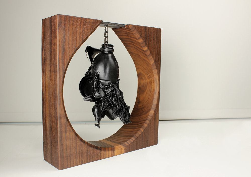 Pendulum, 2018   Walnut, steel, assorted waste  Inspired by natural beauty and the opposing forces. A documentary on human kind and our relationship to a depleting resource.                                                                                                                                                                                $1,000.00